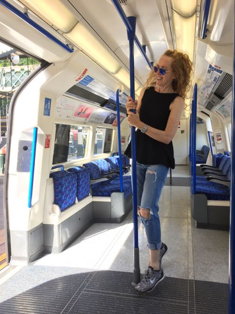 Tube Train, London Underground, ripped jeans, trainers, sunglasses, pole