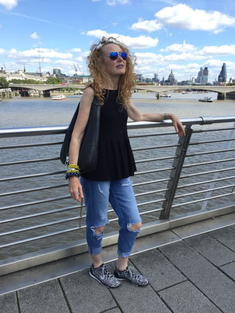 River Thames, London skyline, ripped Jeans, sunglasses, Gucci handbag, Nike trainers, Bridge