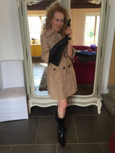 Burberry Raincoat, raincoat, black leather high heeled boots, red curly hair, vintage mirror, house interior,long leather gloves.