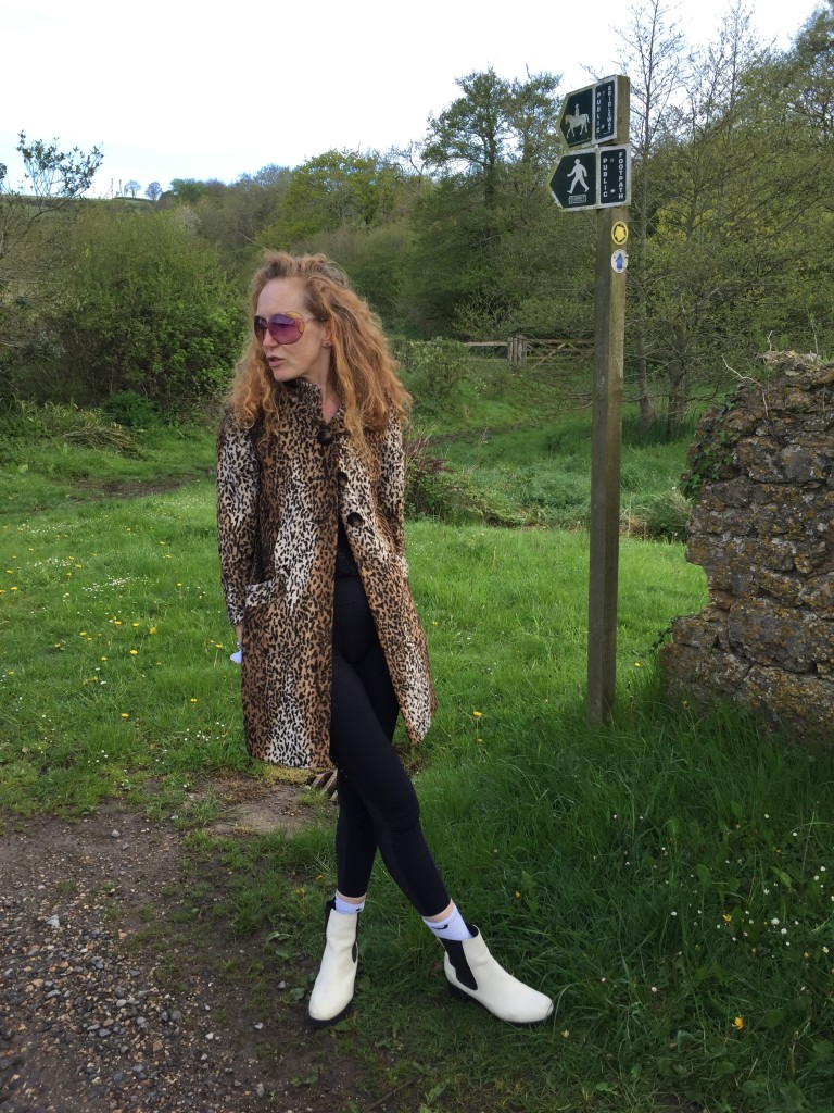 panther print coat, leopard print coat, fake fur, faux fur, MiuMiu Sunglasses,long red curly hair, white Chelsea boots
