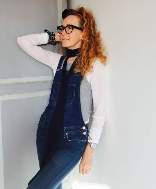 dungarees, skinny scarf, pussy bow, Prada glasses, Rolex Yachtmaster Mans Watch, long sleeved white T Shirt, bracelets.