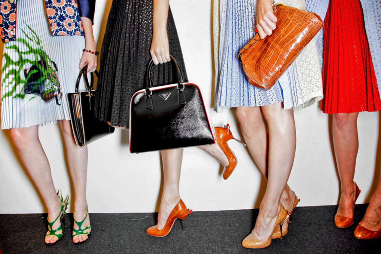 Prada, Miuccia Prada, pleated skirts, midi skirts, Prada pleated skirts, Prada handbags, clutch baga, accessories